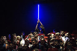 © Licensed to London News Pictures . 16/12/2015 . Manchester , UK . Star Wars fans attend the midnight screening of Star Wars the Force Awakens at the AMC Great Northern cinema in Manchester City Centre . Photo credit : Joel Goodman/LNP