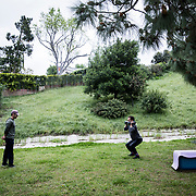 A fitness trainer took to a Los Angeles park to work with his client, both without Personal Protective Equipment, after the gym he leased space from was closed on March 19 as a non-essential business. The order also banned all gatherings outside the home.