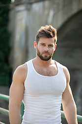 hot guy in a tank top outdoors