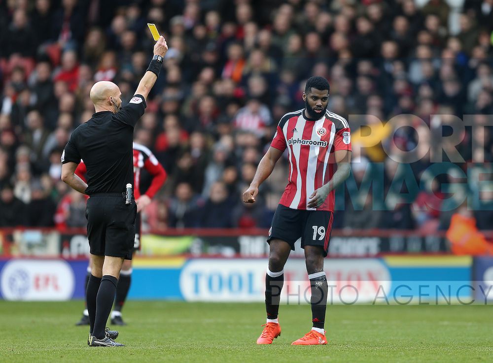 Ethan Ebanks-Landell of Sheffield Utd receives a yellow card during the English League One match at Bramall Lane Stadium, Sheffield. Picture date: December 31st, 2016. Pic Simon Bellis/Sportimage