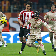 Galatasaray's Emre COLAK (C), Juan Emmanuel CULIO (R) and Sivasspor's Ugur KAVUK (L)  during their Turkish Superleague soccer match Galatasaray between Sivasspor at the Turk Telekom Arena at Aslantepe in Istanbul Turkey on Sunday 23 January 2011. Photo by TURKPIX