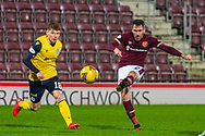 Kieran McKechnie (#18) of Queen of the South FC can't stop Michael Smith (#2) of Heart of Midlothian FC from shooting for goal during the SPFL Championship match between Heart of Midlothian and Queen of the South at Tynecastle Park, Edinburgh, Scotland on 12 December 2020.