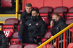 Aberdeen goalkeeper Joe Lewis (centre) among the substitutes during the cinch Premiership match at Pittodrie Stadium, Aberdeen. Picture date: Sunday October 3, 2021.