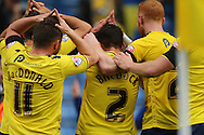 Oxford United defender George Baldock (2) scores the only goal of the game and celebrates with a 'Roofe' celebration to the crowd during the Sky Bet League 2 match between Oxford United and AFC Wimbledon at the Kassam Stadium, Oxford, England on 10 October 2015.