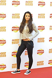 © Licensed to London News Pictures. 29/08/2012. London,UK.Katie Price and Leandro Penna attending to the launch of new Walkers Deep Ridged crisps.To celebrate the launch Walkers will unveil 'Britain's Biggest Ever Crisp', a 22m high x 26m .Photo credit : Thomas Campean/LNP. .
