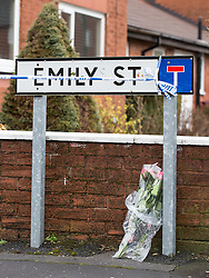 © Licensed to London News Pictures . 11/02/2014 . Blackburn , UK . Flowers left at the side of the road . Police and forensic examiners on Emily Street in Blackburn at the scene where an eleven month old baby girl was mauled to death late last night (10th February 2014) . Photo credit : Joel Goodman/LNP