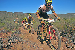 ROBERTSON, SOUTH AFRICA - MARCH 20: Riders ascend a singletrack climb lead by Enrique Morcillo Vergara during stage two's 110km from Robertson on March 20, 2018 in Cape Town, South Africa. Mountain bikers from across South Africa and internationally gather to compete in the 2018 ABSA Cape Epic, racing 8 days and 658km across the Western Cape with an accumulated 13 530m of climbing ascent, often referred to as the 'untamed race' the Cape Epic is said to be the toughest mountain bike event in the world. (Photo by Dino Lloyd)