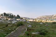 Morning at a hazy (smoke from a forest fire) Lake Virginia; John Muir Wilderness, Sierra National Forest, Sierra Nevada Mountains, California, USA.
