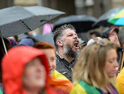 Pictured: A protester attempted to shout down one of the speakers outside the City Chambers.<br /> <br /> Thousands of marchers rallied outside the Scottish Parliament to celebrate the annual Scotia Pride event in Edinburgh.<br /> <br /> © Dave Johnston / EEm