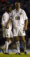 Photo. Aidan Ellis, Digitalsport<br /> Leeds United v Fulham.<br /> FA Barclaycard Premiership.<br /> 14/12/2003.<br /> Leeds match winner Dominic Matteo with Jermain Pennant.
