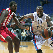 Anadolu Efes's Stephane Lasme (R) and Olympiacos's Othello Hunter (L) during their Gloria Cup Basketball Tournament match Anadolu Efes between Olympiacos at Ulker Sports Arena in istanbul Turkey on Tuesday 23 September 2014. Photo by Aykut AKICI/TURKPIX