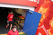 Gareth Bale of Wales (l) exits the tunnel and looks up at a large artwork of himself as he arrives for Wales football team training at the Cardiff city Stadium in Cardiff , South Wales on Saturday 8th October 2016, the team are preparing for their FIFA World Cup qualifier home to Georgia tomorrow. pic by Andrew Orchard, Andrew Orchard sports photography