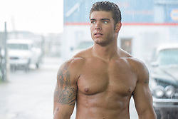 shirtless auto mechanic at a garage portrait of a handsome shirtless man with a green eyes and muscular body shirtless muscular auto mechanic with dirt on his face and  body at an auto body repair shop