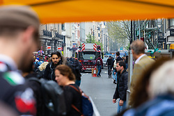 A fire engine on its way to an emergency has to detour away from its direct route as hundreds of environmental protesters from Extinction Rebellion occupy Oxford Circus, a pink yacht being the focal point of their presence, with traffic denied access to two of London's busiest streets. London, April 16 2019.