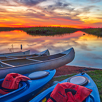 South Florida kayaking outdoors adventure photography from landscape photographer Juergen Roth showing kayaks with a stunning sunset across Loxahatchee National Wildlife Refuge located west of Boynton Beach in Palm Beach County, FL. Arthur R. Marshall Loxahatchee National Wildlife Refuge is an amazing area for viewing wildlife and photography in Florida. <br /> <br /> Sunset photography images of the Arthur R. Marshall Loxahatchee National Wildlife Refuge area are available as museum quality photo prints, canvas prints, wood prints, acrylic prints or metal prints. Fine art prints may be framed and matted to the individual liking and decorating needs:<br /> <br /> https://juergen-roth.pixels.com/featured/florida-kayaking-outdoors-adventure-juergen-roth.html<br /> <br /> All digital nature photo images are available for photography image licensing at www.RothGalleries.com. Please contact me direct with any questions or request.<br /> <br /> Good light and happy photo making!<br /> <br /> My best,<br /> <br /> Juergen<br /> Prints: http://www.rothgalleries.com<br /> Photo Blog: http://whereintheworldisjuergen.blogspot.com<br /> Instagram: https://www.instagram.com/rothgalleries<br /> Twitter: https://twitter.com/naturefineart<br /> Facebook: https://www.facebook.com/naturefineart