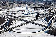 Nederland, Utrecht, Oudenrijn, 31-01-2010; knoopppunt Oudenrijn in de sneeuw, gezien naar Polder Papendorp met het gelijknamige kantorenpark en Kanaleneiland, rijksweg A12 naar diagonaal, vlnr de A2. Oudenrijn junction, near Utrecht, in the snow..<br /> luchtfoto (toeslag), aerial photo (additional fee required).foto/photo Siebe Swart