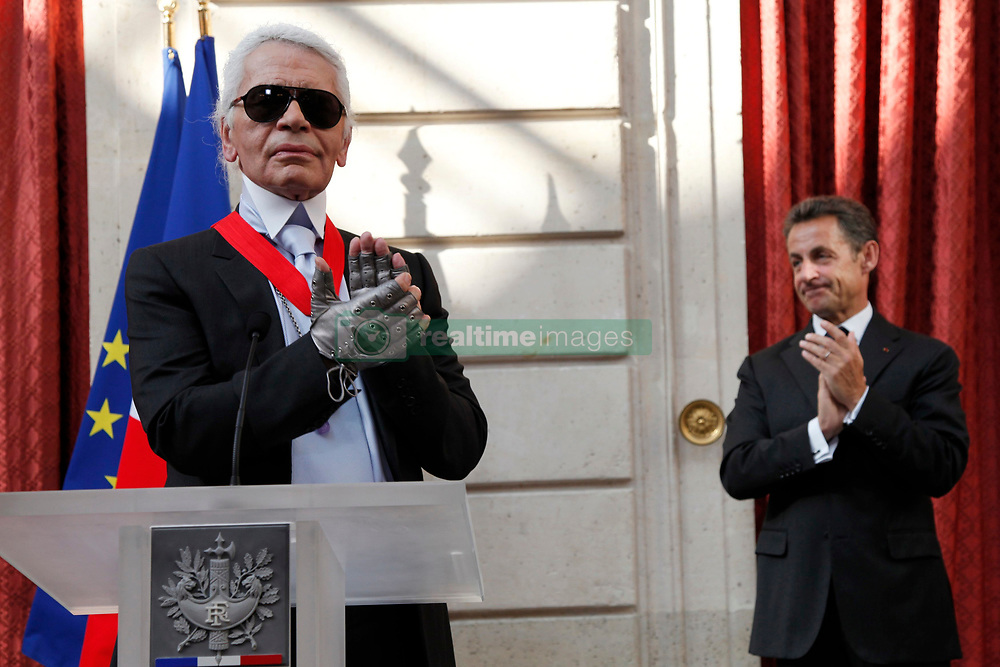 German fashion designer Karl Lagerfeld (L) applauds after he received the Commander's Cross of the Legion of Honour (Croix de Commander de la Legion d'Honneur) from France's President Nicolas Sarkozy at a ceremony at the Elysee Palace in Paris, France on June 3, 2010. Photo by Jacky Naegelen/Pool/ABACAPRESS.COM