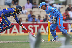 © Licensed to London News Pictures. 14/02/2012. Adelaide Oval, Australia. M.S Dhoni (right) breaks the stumps in an attempt to run out Lasith Malinga (right) during the One Day International cricket match between India Vs Sri Lanka. Photo credit : Asanka Brendon Ratnayake/LNP