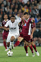 Ricardo Cadu (R) of CFR Cluj challenges Anderson (L) of Manchester United during the UEFA Champions League, Group H, soccer match at Dr. Constantin Radulescu Stadium in Cluj-Napoca, Romania, 2 October 2012.