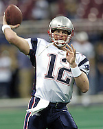 New England Patriots quarterback Tom Brady, warms up during pre-game, before the Patriots play the St. Louis Rams at the Edward Jones Dome in St. Louis, Missouri, November 7, 2004.