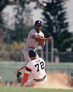 SARASOTA, FL - 1986:  Willie Randolph of the New York Yankees makes a force play on Carlton Fisk of the Chicago White Sox during a major league baseball spring training game at Payne Park in Sarasota, Florida prior to the 1986 season.  (Photo by Ron Vesely) Subject:   Willie Randolph; Carlton Fisk