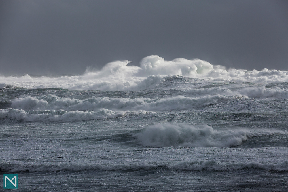 A breaking wave makes unusual shapes on a very stormy sea at Grindavík, south west Iceland
