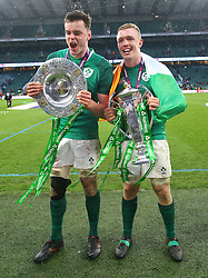 Ireland's James Ryan and Dan Leavy celebrate with the trophy after winning the grand slam during the NatWest 6 Nations match at Twickenham Stadium, London.