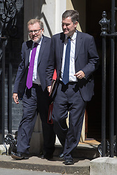 Downing Street, London, July 19th 2016. Scotland Secretary David Mundell and Chief Secretary to the Treasury David Gauke leave the first full cabinet meeting since Prime Minister Theresa May took office.