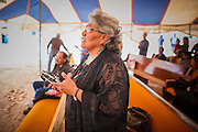 "12 JULY 2012 - FT DEFIANCE, AZ:    Sister ARLINDA SCOTT prays at the 23rd annual Navajo Nation Camp Meeting in Ft. Defiance, north of Window Rock, AZ, on the Navajo reservation. Preachers from across the Navajo Nation, and the western US, come to Navajo Nation Camp Meeting to preach an evangelical form of Christianity. Evangelical Christians make up a growing part of the reservation - there are now more than a hundred camp meetings and tent revivals on the reservation every year. The camp meeting in Ft. Defiance draws nearly 200 people each night of its six day run. Many of the attendees convert to evangelical Christianity from traditional Navajo beliefs, Catholicism or Mormonism. ""Camp meetings"" are a form of Protestant Christian religious services originating in Britain and once common in rural parts of the United States. People would travel a great distance to a particular site to camp out, listen to itinerant preachers, and pray. This suited the rural life, before cars and highways were common, because rural areas often lacked traditional churches.PHOTO BY JACK KURTZ"