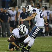 ORLANDO, FL - OCTOBER 09: Trevor Samson #27 of the Brigham Young Cougars kicks the football  at Bright House Networks Stadium on October 9, 2014 in Orlando, Florida. (Photo by Alex Menendez/Getty Images) *** Local Caption *** Trevor Samson