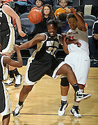 Feb. 3, 2011; Charlottesville, VA, USA; Wake Forest Demon Deacons guard Asia Williams (33) fights for the loose ball with Virginia Cavaliers forward Jazmin Pitts (21) during the game at the John Paul Jones Arena. Virginia won 73-46. Mandatory Credit: Andrew Shurtleff