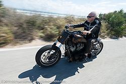 Arlen Ness riding AIA north of Daytona during the Daytona Bike Week 75th Anniversary event. FL, USA. Monday March 7, 2016.  Photography ©2016 Michael Lichter.