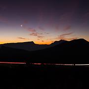 Cars along route to Piton de la Fournaise at sunset