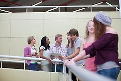 Students leaning on railings (Credit Image: © Image Source/Albert Van Rosendaa/Image Source/ZUMAPRESS.com)