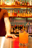 """The Whiskey Soda Lounge in Portland, Oregon's SE Neighborhood serves up aahaan kap klaem, the drinking food of Thailand, and the same drinks menu as its mother restaurant, Pok Pok. Pictured here is the signature """"Rhubarb Plush"""" cocktail: aperol, gin, fresh lime and rhubarb bitters."""