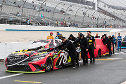 October 5, 2018 - Dover, DE, U.S. - DOVER, DE - OCTOBER 05: Crews roll the cars back to the garage after qualifying for the Monster Energy NASCAR Cup Series Gander Outdoors 400 was canceled on October 05, 2018, at Dover International Speedway in Dover, DE.(Photo by David Hahn/Icon Sportswire) (Credit Image: © David Hahn/Icon SMI via ZUMA Press)