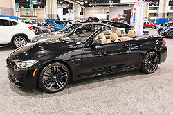 CHARLOTTE, NC, USA - November 11, 2015: BMW M4 convertible on display during the 2015 Charlotte International Auto Show at the Charlotte Convention Center in downtown Charlotte.