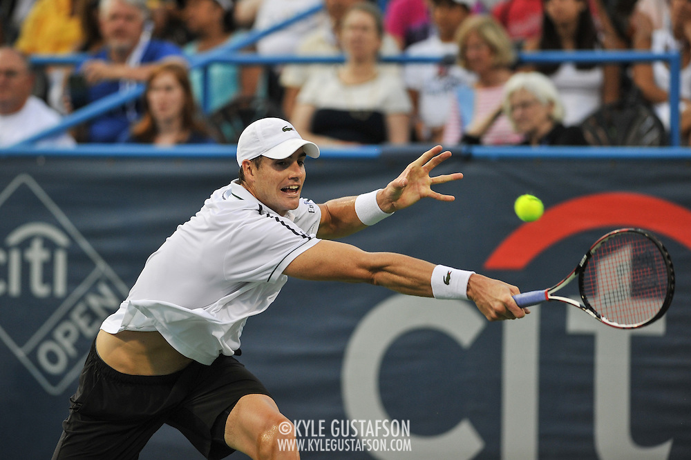 JOHN ISNER of the United States plays against Victor Estrella Burgos of the Dominican Republic at Day 3 of the Citi Open at the Rock Creek Tennis Center in Washington, D.C. Isner won in straight sets.