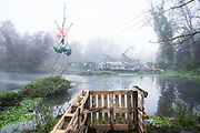 Dan Hooper, better known as roads protester Swampy during the 1990s, occupies a tripod positioned in the river Colne in order to try to delay bridge building works in connection with the HS2 high-speed rail link on 7th December 2020 in Denham, United Kingdom. Anti-HS2 activists continue to resist the controversial £106bn rail project from a series of protest camps based along its initial route between London and Birmingham.