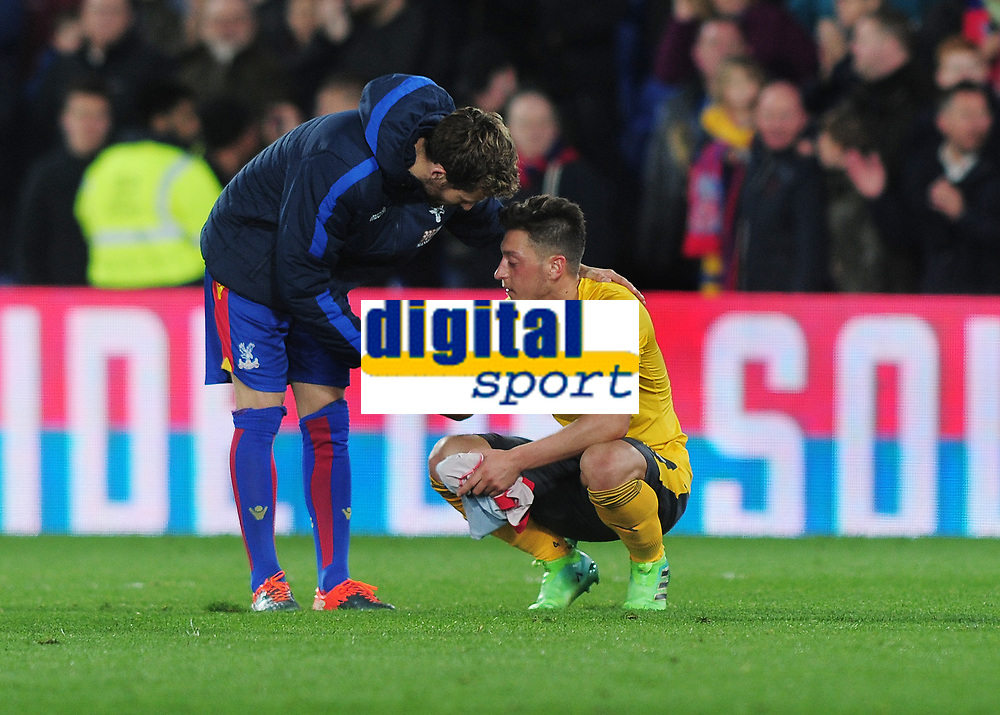 Football - 2016 / 2017 Premier League - Crystal Palace vs. Arsenal<br /> <br /> A dejected Mesut Ozil of Arsenal after the final whistle is consoled by Yohan Cabaye at Selhurst Park.<br /> <br /> COLORSPORT/ANDREW COWIE