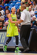 Aerial Powers of the Dallas Wings gets a hug from coach Fred Williams after fouling out against the Connecticut Sun during a WNBA preseason game in Arlington, Texas on May 8, 2016.  (Cooper Neill for The New York Times)