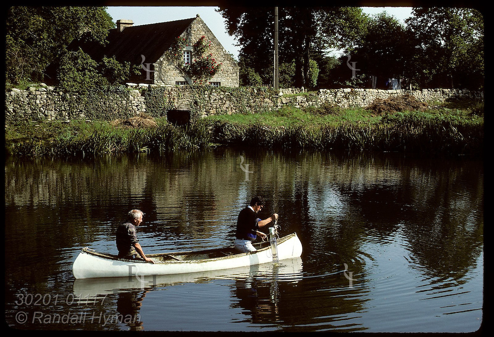 Jean Pierre Allenou of IFREMER takes water samples from mill pond polluted by fish cannery. France