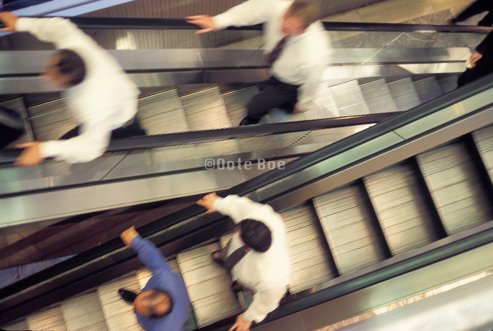 business man moving up and down on escalator