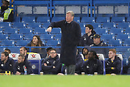 AFC Wimbledon manager Wally Downes making hand gesture during the EFL Trophy match between U21 Chelsea and AFC Wimbledon at Stamford Bridge, London, England on 4 December 2018.