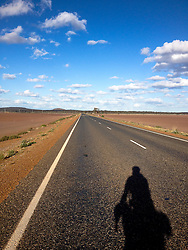 © Licensed to London News Pictures. 11/09/2013. Coolgardie-Esperance Highway,<br /> Norseman Western Australia, Australia. This Highway includes a 90 miles long straight! It's the longest straight road in Australia.  The previous parts of James Ketchell's global triathlon were an Atlantic solo row in 2010 and summiting Everest in 2011.Photo credit : James Ketchell/LNP