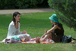 © Licensed to London News Pictures 15/06/2021. Greenwich, UK. Friends relax in Greenwich park, London today enjoying the warm weather. Photo credit:Grant Falvey/LNP