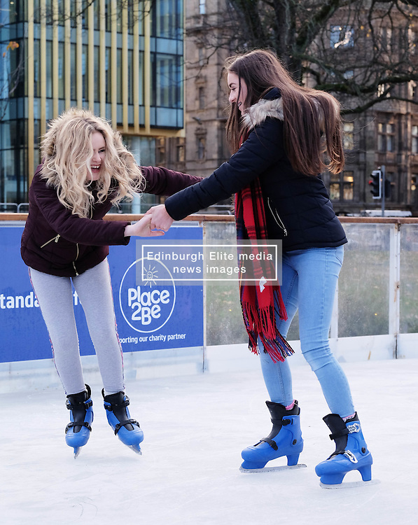 Edinburgh's Christmas 2016, Friday 18th November 2016<br /> <br /> The Edinburgh's Christmas Ice Rink in St Andrew's Square opened to the public today.<br /> <br /> !3-year-olds Katie Millwood (wearing a tartan scarf) and Melissa Heron were first on the ice.<br /> <br /> (c) Alex Todd   Edinburgh Elite media
