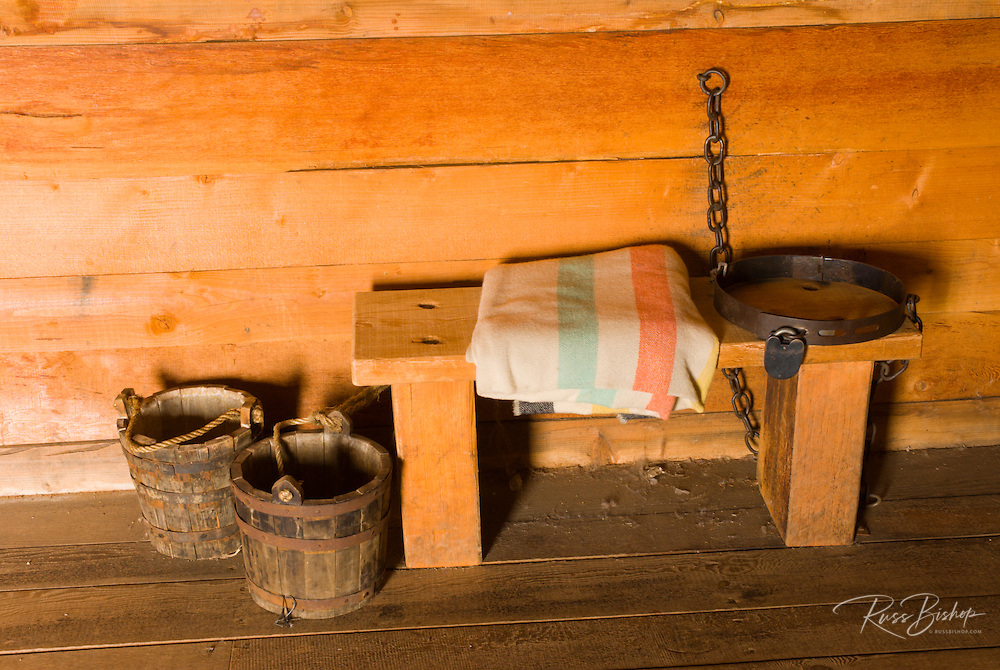 Bench, buckets, and shackle in the jail, Fort Vancouver National Historic Site, Vancouver, Washington