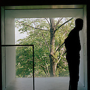 Figure by a window in a main art gallery of Stockholm, Sweden