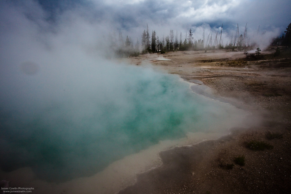 Steaming hot spring in West thumb Geyser Basin in Yellowstone National Park